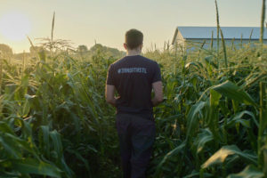 Man walking through field with 39 North Shirt